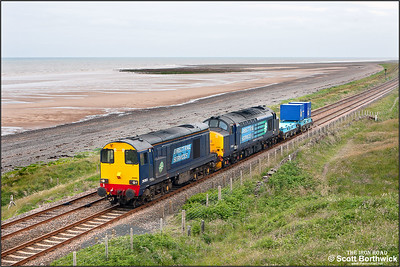 20303+37425 pass the golf course at Seascale with 6K73 0851 SO Sellafield BNF-Crewe Coal Sdgs. The train conveyed a couple of PFA's for Berkeley.