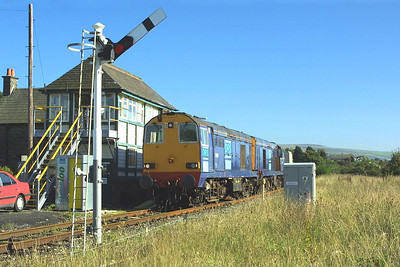 20314+20308 pass Foxfield on 08/09/2004 with 6C52 1605 Heysham PS-Sellafield. The train was running around two hours early resulting in the sun not being far enough round.