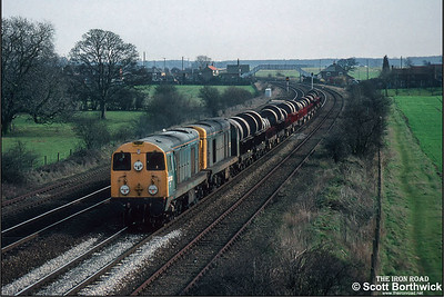20092+20185 pass Melton Ross whilst working 6T48 from Grimsby conveying steel coil on BVW's on 06/03/1992.