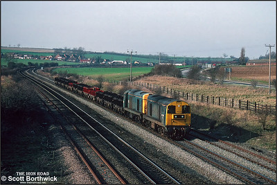 20185+20092 pass Melton Ross with a rake of empty BVW steel coil carriers destined for Grimsby Docks for loading on 06/03/1992.