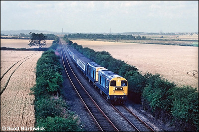 20185+20148 pass Gonerby Moor whilst working 1E86 0926 Derby-Skegness relief on 08/08/1991.