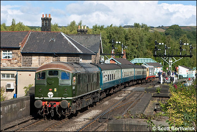 D5061 and the ECS to form 2A33 1210 Grosmont-Goathland are dragged into Grosmont by 20227 on 18/09/2010.