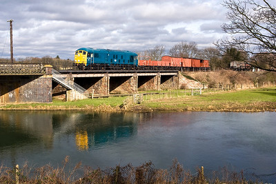 24081 crosses the River Nene at Wansford with a short mixed freight on 23/02/2008.