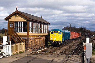 24081 passes the signal box at Wansford with a short mixed freight on 23/02/2008.