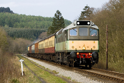 In the first sun of the 2007 Diesel Gala, D7628 (25278) passes the platelayers cottages at Yorfalls Wood on 20/04/2007 with 2P17 1615 Grosmont-Pickering.