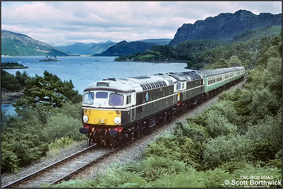 On Wednesdays during the Summer of 1993, celebrities D5300 & D5301, aka 26007 & 26001, were diagrammed to work an Inverness-Kyle of Lochalsh and return service. The next 8 pictures illustrate this working. Here on 25/08/1993 26007+26001 'Eastfield' disturb the peace and tranquility at Plockton with 2H85 1235 Inverness-Kyle of Lochalsh.