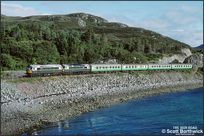 Shortly after departure from Kyle of Lochalsh, 26001+26007 are seen at Badicaul with 2H86 1705 Kyle of Lochalsh-Inverness on 25/08/1993.