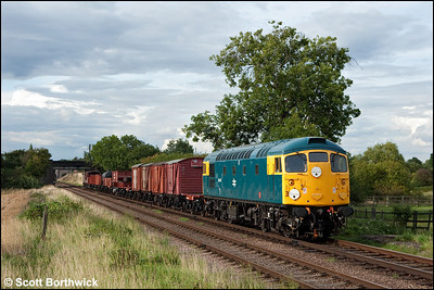 26007 passes Woodthorpe with a mixed freight on 07/09/2010.