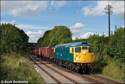 26007 passes Rabbit Bridge with a mixed freight on 07/09/2010.