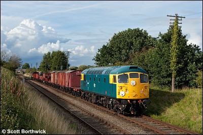 26007 is seen between Woodthorpe and Quorn & Woodhouse with a mixed freight on 07/09/2010.