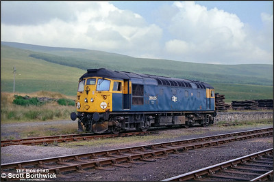 26035 stands dumped in a siding at Achnasheen after failing with a hot axle box whilst working 2K08 1045 Inverness-Kyle of Lochalsh on 25/07/1983.