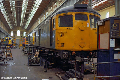 26029 is undergoing overhaul in the erecting shop at St Rollox on 24/07/1983.