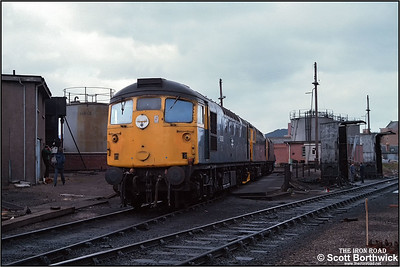 26036, 26041 & 26024 are stabled behind the fuel road on Inverness TMD (IS) at 1230 on 21/04/1984.
