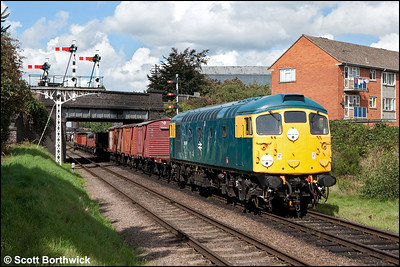 26007 passes the signal gantry at Beeches Road, Loughborough with a mixed freight on 07/09/2010.
