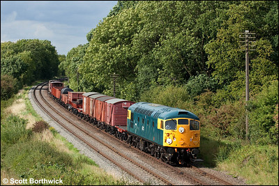 26007 passes Kinchley Lane with a mixed freight on 07/09/2010.