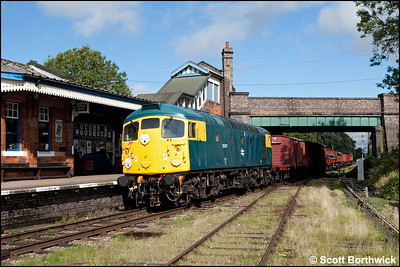 26007 passes Quorn & Woodhouse with a mixed freight on 07/09/2010.