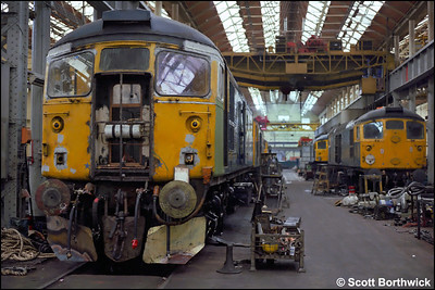 26028 undergoes overhaul in the erecting shop at St Rollox on 24/07/1983.