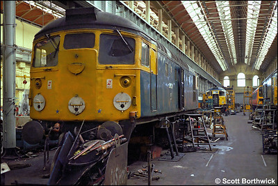 26023 undergoing work in the erecting shop at St Rollox on 24/07/1983.