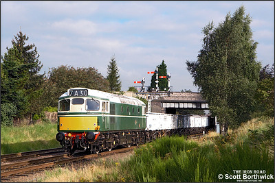D5401 (27056) passes the fine bracket signal at Beeches Road, Loughborough with the 'Windcutter' rake of open mineral wagons during an EMRPS photo charter on 04/09/2007.
