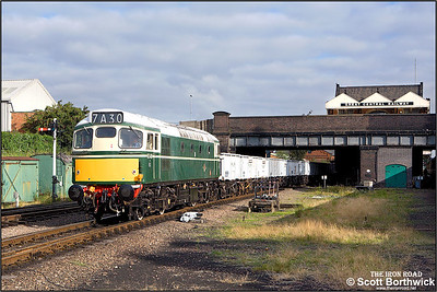 D5401 (27056) departs from Loughborough Central with the 'Windcutter' rake of open mineral wagons during an EMRPS photo charter on 04/09/2007.