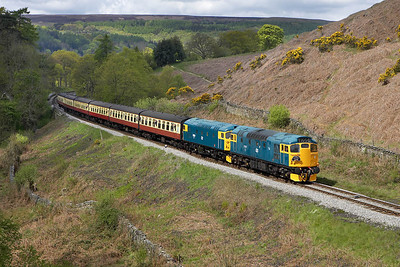 27001+26024 make a fine sight as they climb up to Goathland at Thomason Foss on 13/05/2005 with the 1145 Grosmont-Pickering service. 26024 wasn't performing too well at this point with 27001 doing all the work. It was removed at Pickering where repairs were undertaken enabling it to resume its duties later in the day.