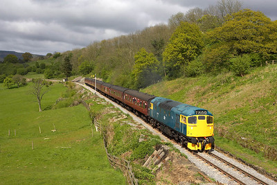 27001 tackles the grade at Green End with the 1545 Grosmont-Pickering service during a brief burst of sunshine on 13/05/2005.