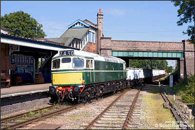 D5401 (27056) arrives at Quorn & Woodhouse with the 'Windcutter' rake of open mineral wagons during an EMRPS photo charter on 04/09/2007.