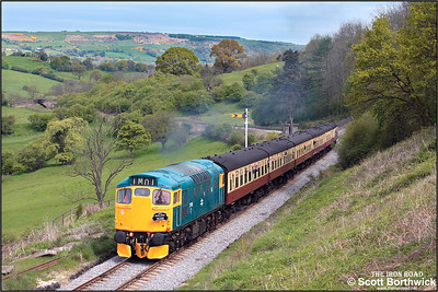 27001 is pictured climbing the bank at Green End whilst working the 1145 Grosmont-Pickering service on 15/05/2005.