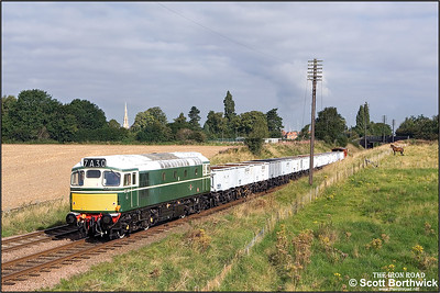 D5401 (27056) passes Woodthorpe with the 'Windcutter' rake of open mineral wagons during an EMRPS photo charter on 04/09/2007.