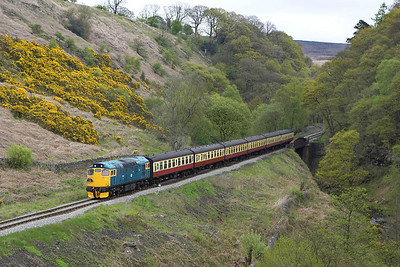 With the earlier failure of 26024, 27001 returned with the 1315 Pickering-Grosmont service single handed. The train is seen here decending the bank at Thomason Foss on 13/05/2005.