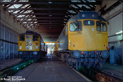27066 and 26015 stand inside the shed at Inverness TMD on 21/07/1983.