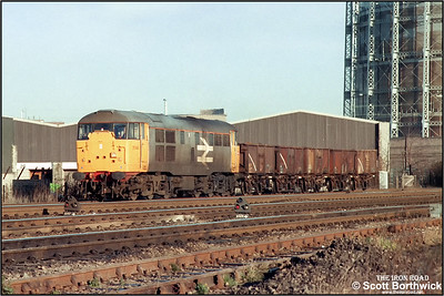 31144 passes Washwood Heath with a trip working from Washwood Heath Sdgs-Bordesley conveying a short rake of open wagons for loading with scrap metal on 19/12/1986.
