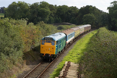 31101 emerges from the shadows as it powers away from Market Bosworth on 25/09/2005 with the 1430 Shenton-Shackerstone service.