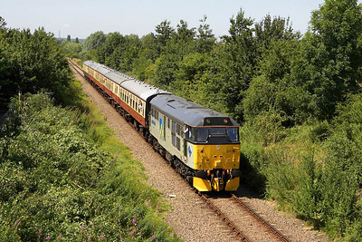 31271 passes Mill Lane, Castor whilst working the 1245 Wansford-Peterborough service on the Nene Valley Railway 17/07/2005.
