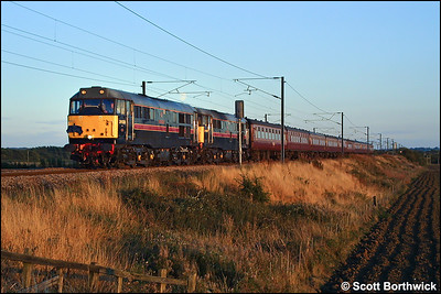 In rapidly fading autumnal sunshine 31128+31459 head 'The St James Day Tripper' 1Z44 1642 Norwich-Preston at Frinkley Lane, Marston on 06/09/2003.
