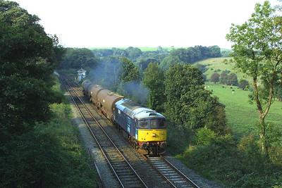 33030 passes Dalton Junction with 6P24 0825 TuFO Sellafield-Runcorn Folly Lane on 10/09/2004.