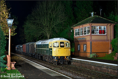 D6566 (33048) arrives at Crowcombe Heathfield with a mixed freight for Minehead on 12/11/2011.