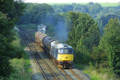33030 passes Dalton Junction with 6P24 0825 TuFO Sellafield-Runcorn Folly Lane on 10/09/2004.