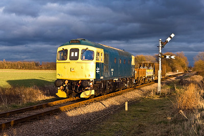 33053 passes Sutton Cross with a short mixed freight on 23/02/2008.
