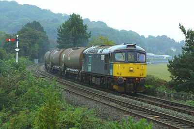 33030 passes Grange over Sands in heavy rain on 10/09/2004 with 6P27 1443 TuFO Runcorn Folly Lane-Sellafield.