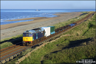 Running alongside the Irish Sea at Seascale, 33030 powers 7C20 0752 Sellafield-Drigg trip working conveying low level radioactive waste on 09/09/2004.