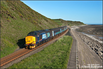The driver of 37409 seems happy with life as his steed hauls 2C47 1731 Barrow in Furness-Carlisle along the Cumbrian coastline at St Bees on 23/05/2016.