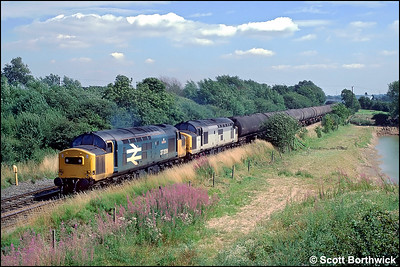 37209 'Phantom'+37285 pass Barrow upon Trent whilst working 6M57 0859 Humber Oil Refinery-Kingsbury Oil Sdgs on 15/08/1991.
