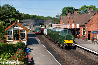 56062 brings up the rear of the 0945 Sheringham-Holt service lead by 51192 as D6732 (37032) awaits the token at Weybourne with a mixed freight for Sheringham as on 12/06/2014.