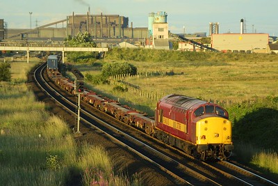 In glorious late evening Summer sunshine 37706 passes Southbank, Middlesbrough at the head of 6N50 2052 Tees Dock-Tees NY on 10/07/2003.