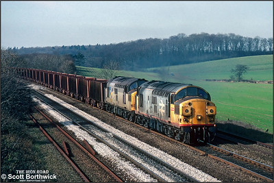 37351+37250 pass Knabbs Bridge, Melton Ross with a Santon-Immingham Ore Terminal iron ore empties on 06/03/1992.