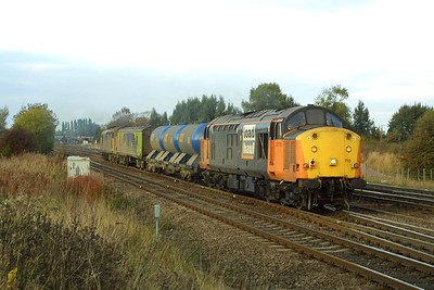 37710+37516 rumble past Milford Junction in fading light on 18/10/2003 whilst working 6T80 1634 Strensall-Healey Mills water cannon train.