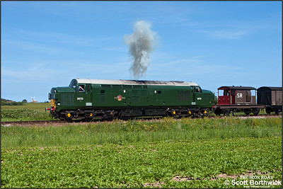 D6732 (37032) powers away from Weybourne's home signal with a Sheringham-Weybourne mixed freight on 12/06/2014.