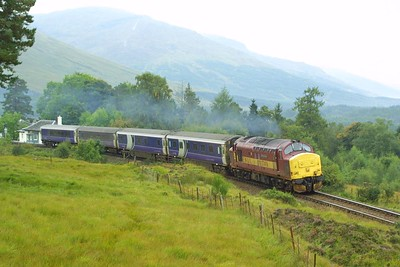 37416 restarts 1Y11 0450 Edinburgh Waverley-Fort William away from Bridge of Orchy in typical West Highland weather on 22/09/2001.