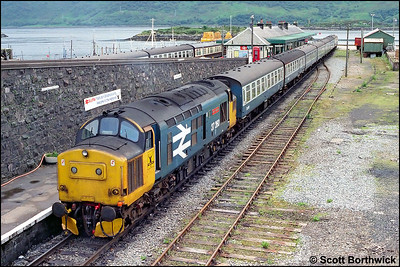 37260 'Radio Highland' stands at Kyle of Lochalsh with 2H86 1400 Kyle of Lochalsh-Inverness on 14/07/1985.
